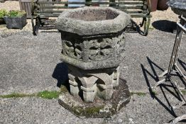 A large weathered reconstituted stone font planter in the Gothic style, 20th century