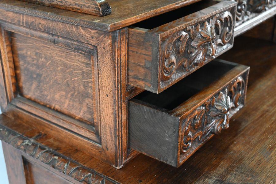 An antique Continental carved oak desk - Image 6 of 7