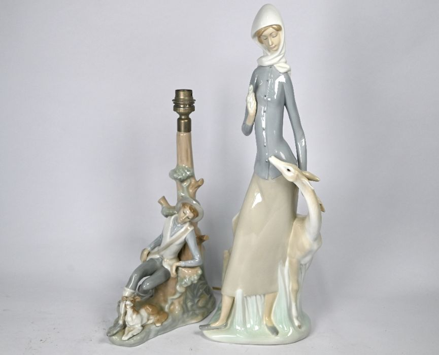 A large Lladro figure of a young woman