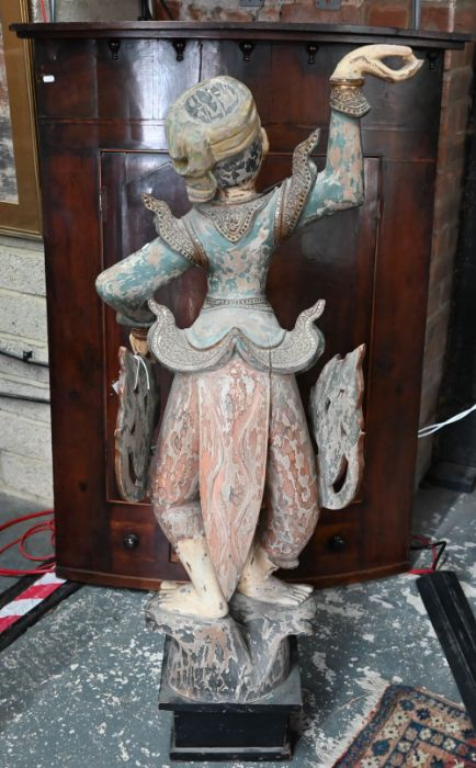 A carved wood figure of a deity - Image 2 of 2