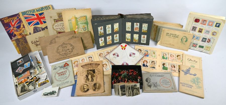 A small quantity of cigarette cards and other trade cards