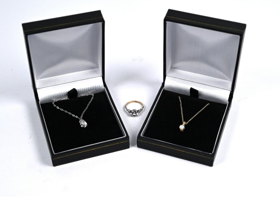 Two pendants on chains and a cz ring
