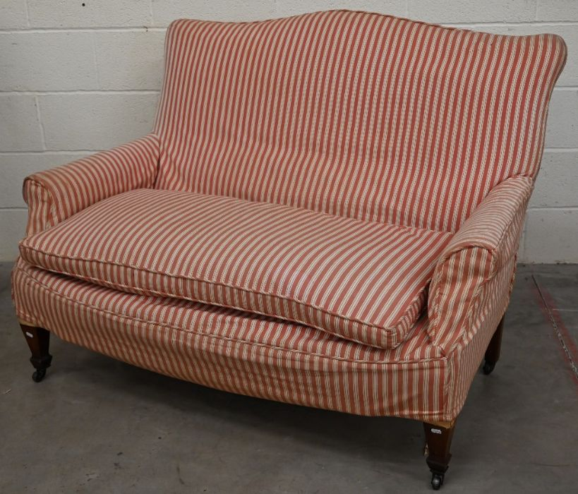 An antique humpback two seat sofa for re-upholstery