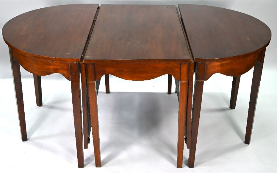 A late George III mahogany D-end dining table