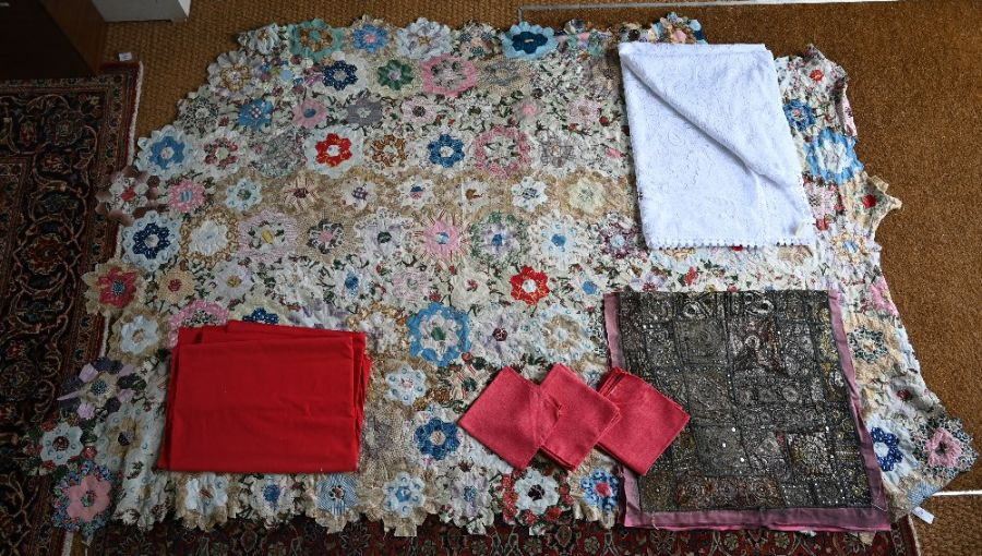 An Indian Sari embroidered wall-hanging, quilt and table linen