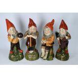 Four large Continental majolica dwarfs