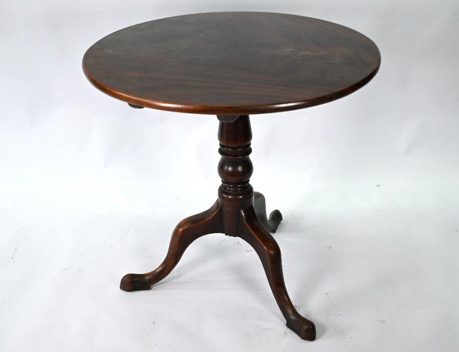 A Georgian mahogany circular tilt-top tripod table