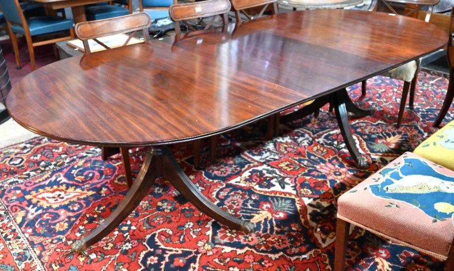 Victorian mahogany twin pedestal 'D' end dining table with extra leaf