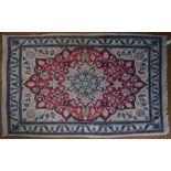 A small Persian Kirman rug