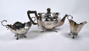 An Edwardian silver three-piece bachelor tea service