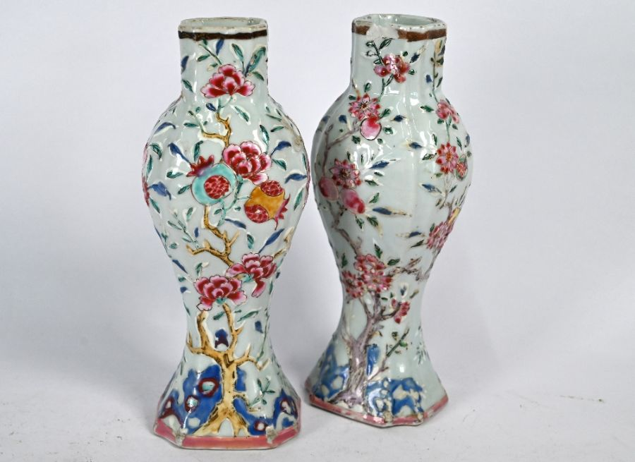 A pair of Chinese Yongzheng/Qianlong period famille rose vases