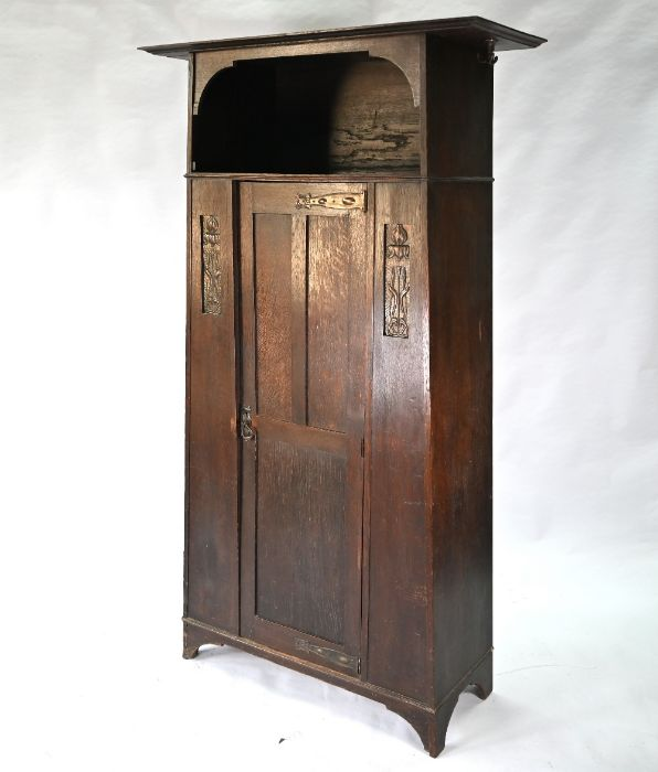 An Art & Crafts oak hall cupboard in the manner of Liberty & Co - Image 4 of 5