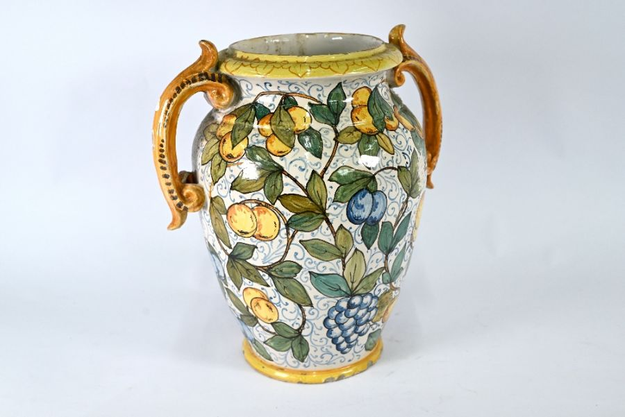 A large majolica decorative vase with twin scroll handles