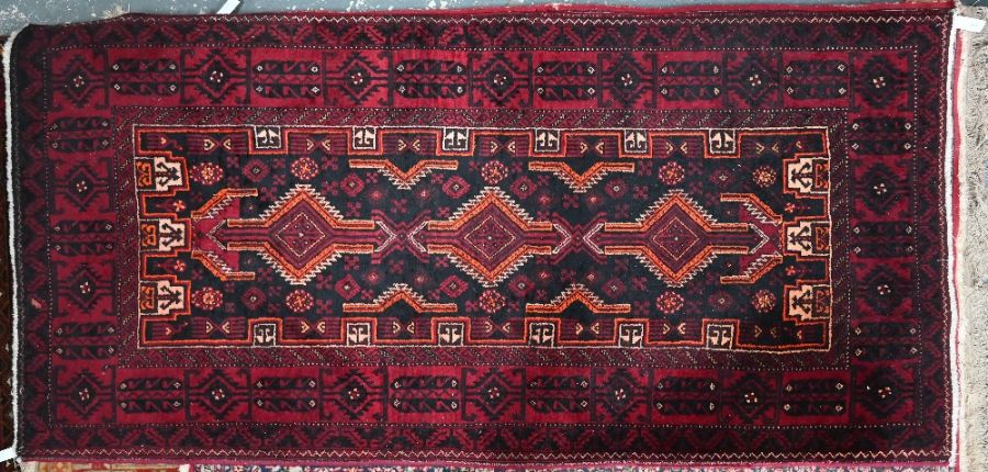 A contemporary red ground Turkish rug