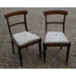 A set of six Regency mahogany bar back dining side chairs