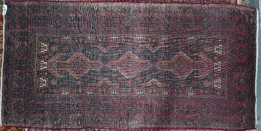 A contemporary red ground Turkish rug - Image 2 of 2