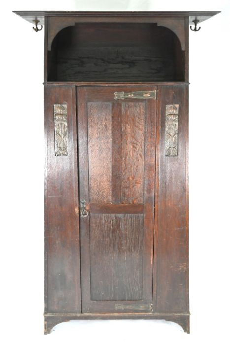 An Art & Crafts oak hall cupboard in the manner of Liberty & Co - Image 2 of 5