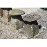 Two antique staddle stones and caps (2)