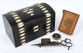 A Victorian ebonised dome-top tea caddy and other items