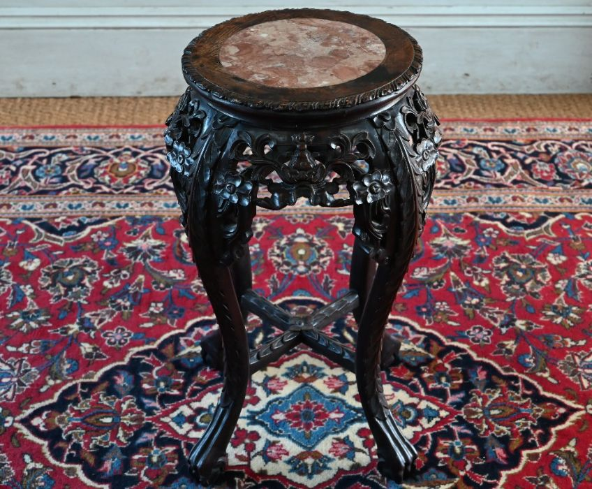 An antique Chinese carved rosewood stand