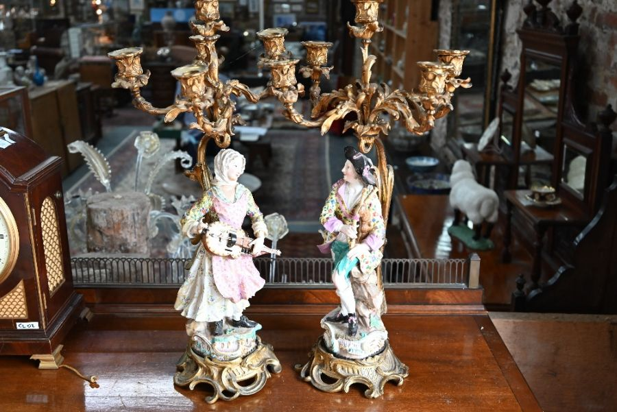 A companion pair of French ormolu mounted candelabra