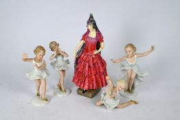 A Royal Doulton figure and four Goebels figures
