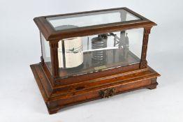 Chadburns Ltd, Liverpool, an oak cased brass barograph