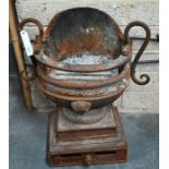 An antique cast iron fire basket in the form of a vase / brazier