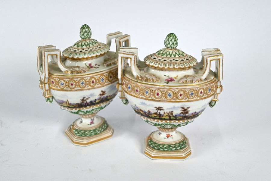 A pair of 19th century Meissen oval urns and covers