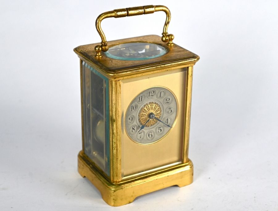 An antique brass two train 8-day carriage clock
