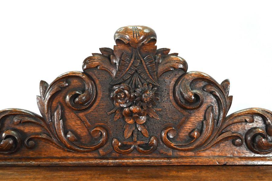 An antique Continental carved oak desk - Image 4 of 7