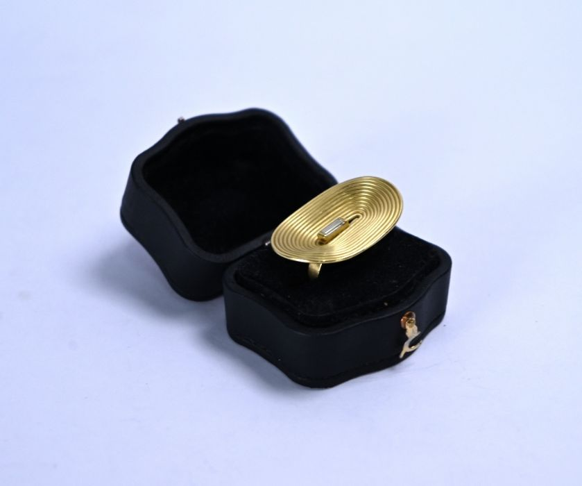 An oversize 18ct gold and diamond ring