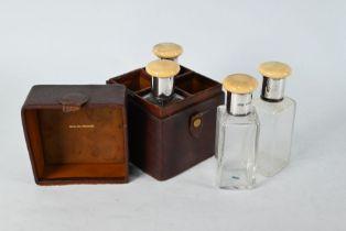 Leather-cased set of four glass spirit flasks