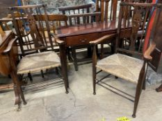 A pair of Arts and Crafts style elbow chairs together with a reproduction mahogany side table