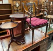A reproduction mahogany elbow chair together with tables