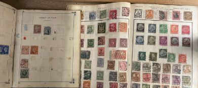 Two stamp albums containing world stamps