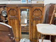A 20th century oak triple wardrobe with a mirrored door 150cm wide x 49cm deep x 196cm high