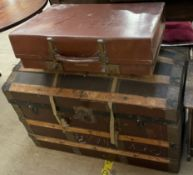 A wooden bound domed top trunk,