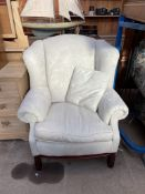 A George III style upholstered wing back library chair,