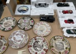 A collection of Franklin Mint model cars together with a collection of Mason Christmas plates