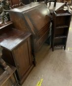 A 20th century oak bureau together with a bedside cabinet and an oak bookcase