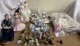 A Royal Doulton figure The cup of tea HN2322, together with two other Royal Doulton figures,