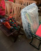 A set of four teak garden dining chairs, together with a new upholstered chair,