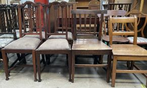 A set of four Edwardian mahogany salon chairs with drop in seats on square tapering legs and square