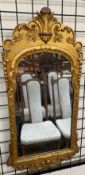 A gilt framed wall mirror,