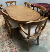 A modern dining table 99cm wide x 179cm long x 78cm high together with six chairs