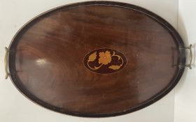 An Edwardian mahogany gallery tray of oval form with brass handles,