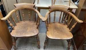 A matched pair of smokers bow elbow chairs, seat 48cm wide x 80.