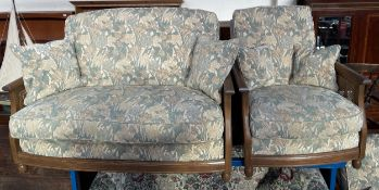 A modern single caned bergere three piece suite comprising a two seater settee and two arm chairs