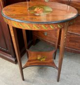 An Edwardian satinwood occasional table with an oval top painted with an image of Diana and Cupid,